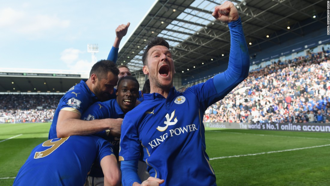Leicester City players celebrate after a late goal lifted them to a 3-2 victory over West Bromwich Albion during a Premier League match played Saturday, April 11, in West Bromwich, England.