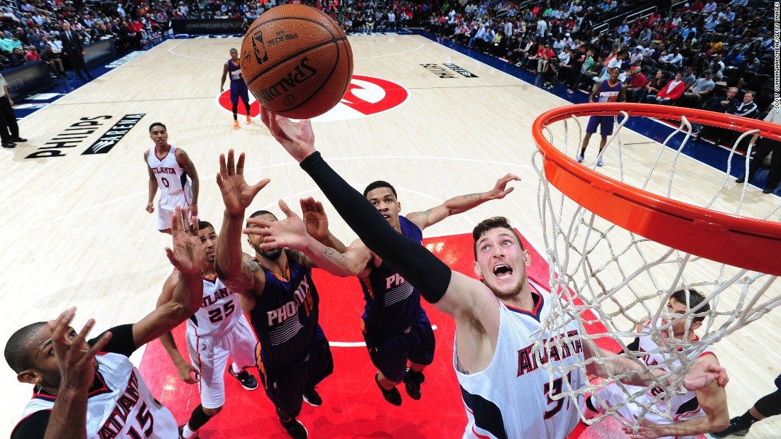 Mike Muscala of the Atlanta Hawks grabs a rebound during a home game against the Phoenix Suns on Tuesday, April 7.