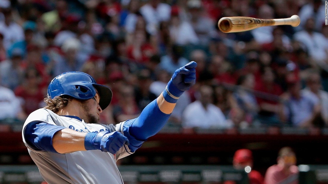 Yasmani Grandal of the Los Angeles Dodgers loses his bat as he makes a swing Sunday, April 12, in Phoenix.