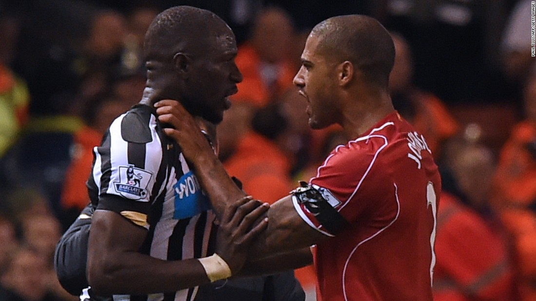 Liverpool defender Glen Johnson (right) clashes with Newcastle United's French midfielder Moussa Sissoko, who was sent off with seven minutes to play for a second yellow card after a bad tackle on Lucas Leiva.