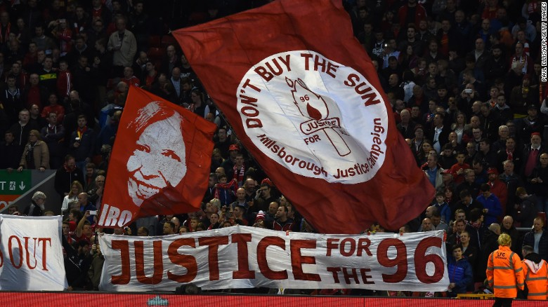 Banners in the crowd mark the 26th Anniversary of the Hillsborough disaster when 96 Liverpool fans died, ahead of the English Premier League football match between Liverpool and Newcastle United at Anfield in Liverpool, north west England on April 13, 2015. AFP PHOTO / PAUL ELLIS RESTRICTED TO EDITORIAL USE. NO USE WITH UNAUTHORIZED AUDIO, VIDEO, DATA, FIXTURE LISTS, CLUB/LEAGUE LOGOS OR LIVE SERVICES. ONLINE IN-MATCH USE LIMITED TO 45 IMAGES, NO VIDEO EMULATION. NO USE IN BETTING, GAMES OR SINGLE CLUB/LEAGUE/PLAYER PUBLICATIONS. (Photo credit should read PAUL ELLIS/AFP/Getty Images)