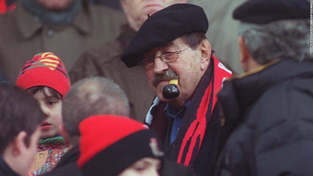 "Famed author of ""The Tin Drum,"" Gunter Grass saw football as a symbol of Germany's struggle with identity in the post-war era. He is pictured in 2000 attending a Bundesliga game in Freiburg, Germany."