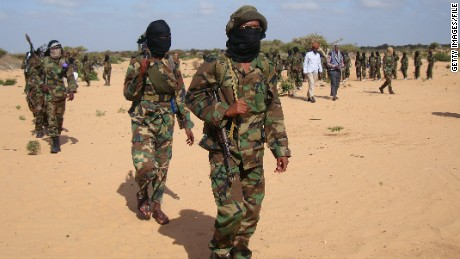 Somali Al-Shebab fighters gather on February 13, 2012 in Elasha Biyaha, in the Afgoei Corridor, after a demonstration to support the merger of Al-shebab and the Al-Qaeda network. Shebab insurgents staged rallies across Somalia on February 13 to celebrate their group's recognition by Osama bin Laden's successor as a member of the Islamist Al-Qaeda network. Al-Qaeda chief Ayman al-Zawahiri announced in a video message posted on jihadist forums on February 9, 2012 that Shebab fighters had joined ranks with the Islamist network. AFP PHOTO / Mohamed Abdiwahab (Photo credit should read Mohamed Abdiwahab/AFP/Getty Images)