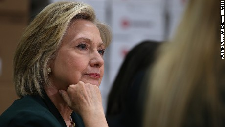 Hillary Clinton looks on during a roundtable discussion with members of the small business community on April 15, 2015, in Norwalk, Iowa.