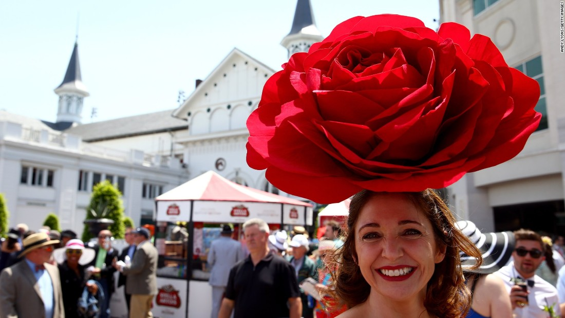A race fan wearing a festive hat attends the 140th running of the Kentucky Derby at Churchill Downs on May 3, 2014 in Louisville, Kentucky.