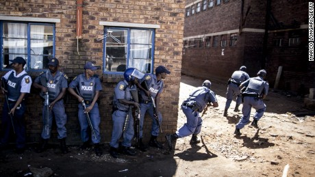 Caption:South African anti-riot policemen raid a hostel in Benoni, outside Johannesburg, on April 16, 2015, whose local residents have been protesting against the presence of Foreign-owned shops in the area, forcing them to shut down and pelting with stones the trucks bringing them supplies. Tensions between locals and foreign nationals erupted in various parts of the country recently, as violence against immigrants in South Africa is common, with unemployed locals accusing foreigners of taking their jobs. AFP PHOTO / MARCO LONGARI (Photo credit should read MARCO LONGARI/AFP/Getty Images) SUBSCRIPTION DOWNLOAD SAVE TO LIGHTBOX Date created:April 16, 2015Editorial #: 469919428 Restrictions:Contact your local office for all commercial or promotional uses. Full editorial rights UK, US, Ireland, Italy, Spain, Canada (not Quebec). Restricted editorial rights elsewhere, please call local office.Licence type:Rights-managed Search results