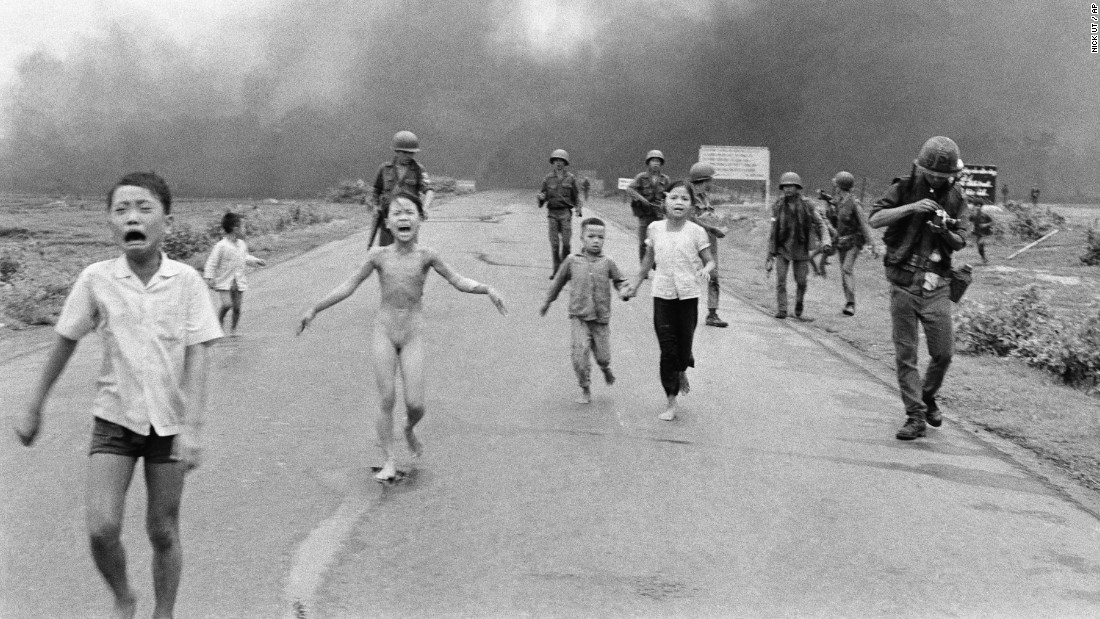 South Vietnamese forces follow after terrified children after a napalm attack on suspected Viet Cong hiding places in June 1972. A South Vietnamese plane accidentally dropped napalm on South Vietnamese troops and civilians. The terrified girl in the center had ripped off her burning clothes while fleeing.