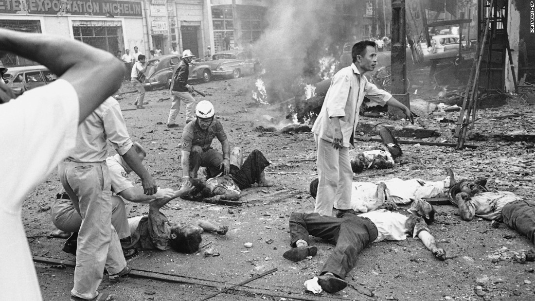 Injured people receive medical aid after an explosion at the U.S. Embassy in Saigon on March 30, 1965.