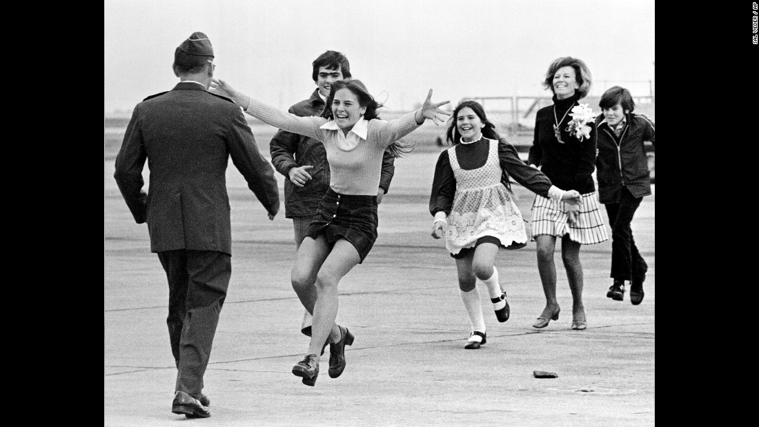 Air Force Lt. Col. Robert L. Stirm, a released prisoner of war, is greeted by his family in Fairfield, California, as he returns home on March 17, 1973.