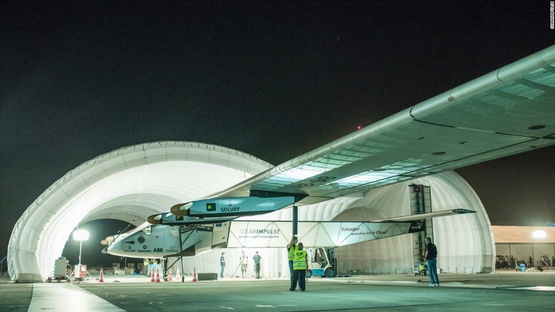 The Solar Impulse 2 is rolled out of its inflatable mobile hangar before leaving Myanmar for Chongqing on Monday, March 30.