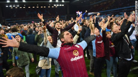 Aston Villa fans celebrate victory on the pitch after the FA Cup Quarter Final match between Aston Villa and West Bromwich Albion at Villa Park on March 7, 2015 in Birmingham, England