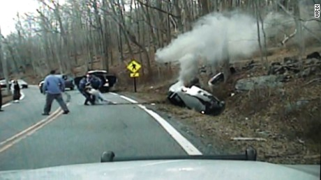 Police dash cam video shows officers dragging woman from car, moments before explosion