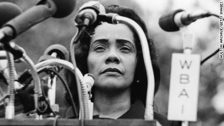 American civil rights campaigner, and widow of Dr. Martin Luther King Jr., Coretta Scott King (1927 - 2006) stands behind a podium covered in microphones at Peace-In-Vietnam Rally, Central Park, New York, April 27, 1968. (Photo by Hulton Archive/Getty Images)