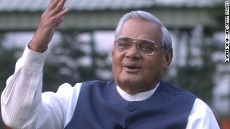 NEW DELHI, INDIA: India's Prime Minister Atal Behari Vajpayee gestures as he poses for photographers at his residence in New Delhi, 25 March 2004. (RAVEENDRAN/AFP/Getty Images)