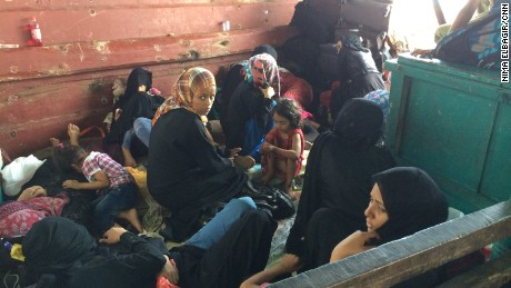 Hanna sits with a group of women on a ship carrying U.S. citizens out of Aden amid fighting.