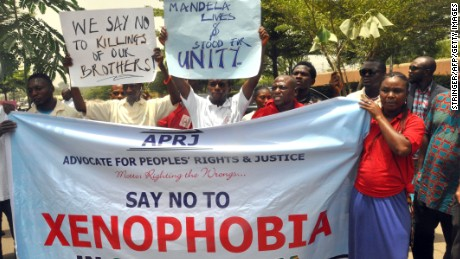 Demonstrators in Abuja, Nigeria, protest against the anti-immigrant violence that erupted in South Africa.