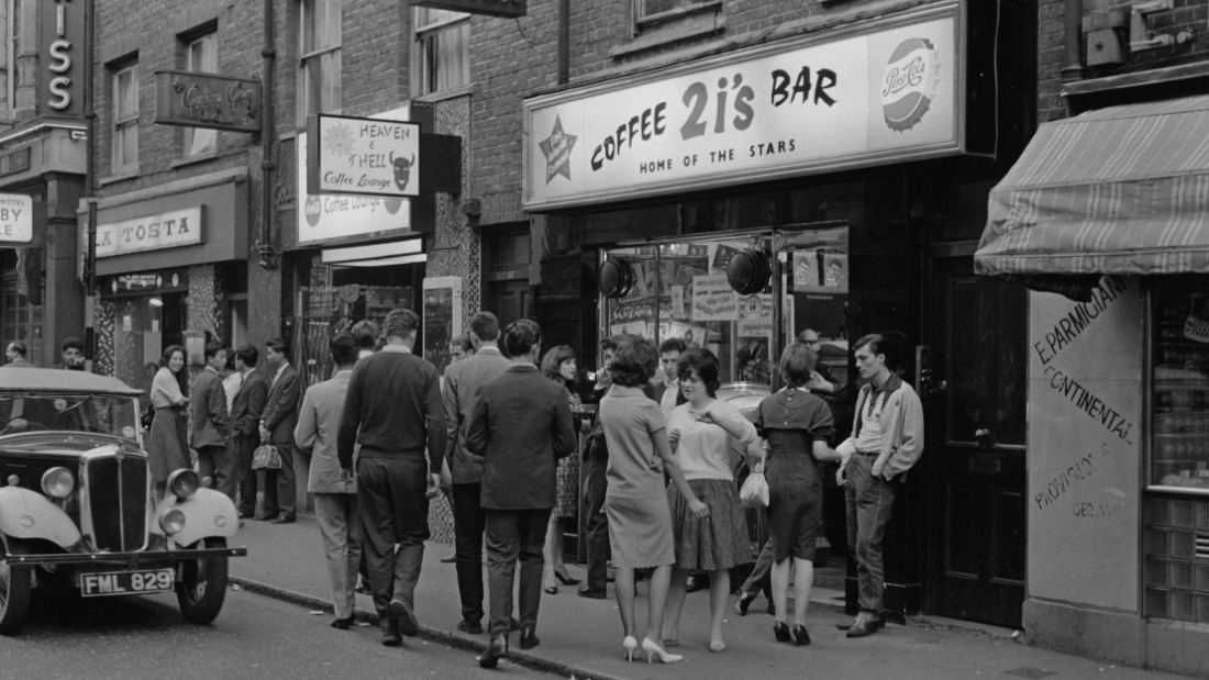 A group of young people outside the 2i's coffee bar in Soho, London, April 1961. Coffee 2i's was the birthplace of British rock n' roll.
