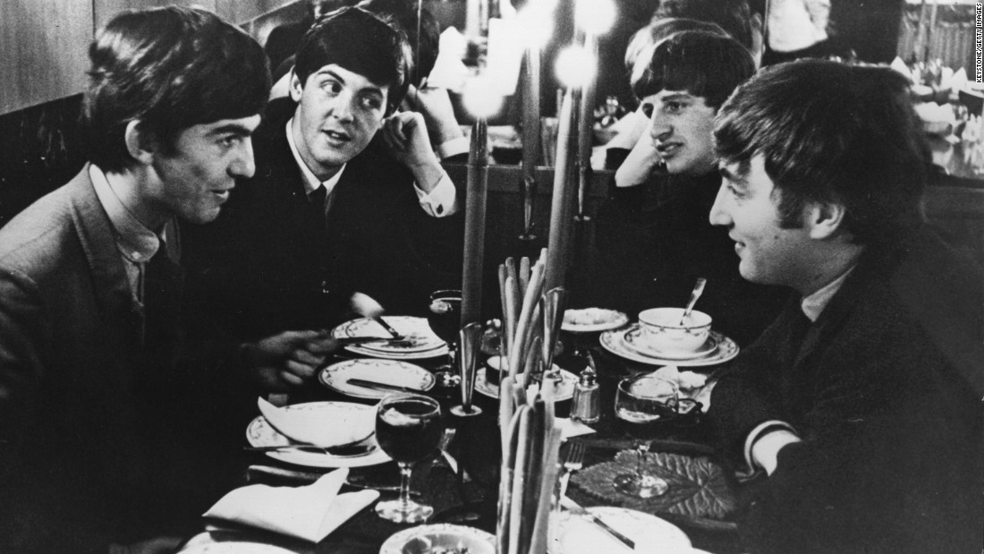 The Beatles meet for the first time after their holidays by candlelight at the Star Steak House in Shaftsbury Avenue, London in 1963. This evening they appear on 'Ready, Steady, Go', the British music television program.