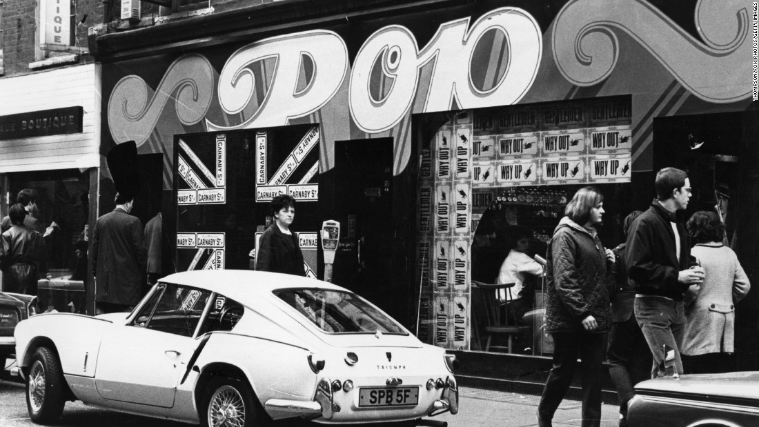 A shop called Pop, on Carnaby Street in London's West End. A Triumph Spitfire GT6 is parked outside.