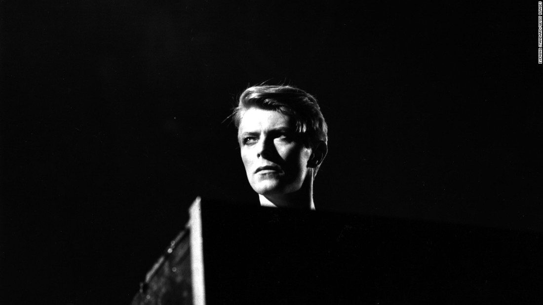 British pop singer David Bowie in concert at Earl's Court, London during his 1978 world tour. During the 1960s, Bowie was a regular on Tin Pan Alley, a meeting place for musicians.
