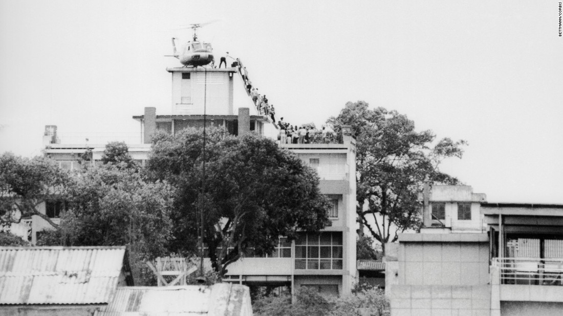 "A CIA employee helps Vietnamese evacuees onto a helicopter near the U.S. Embassy in Saigon on April 29, 1975. Near the war's end, about <a href=""http://www.cnn.com/2015/04/29/us/vietnam-saigon-evacuation-anniversary/index.html"">100 Marine, Air Force and Air America choppers evacuated an estimated 7,000 Americans and South Vietnamese</a> out of the South Vietnamese capital in under 24 hours. It was the largest helicopter airlift in history."