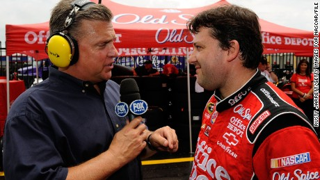 CONCORD, NC - MAY 25:  Fox personality Steve Byrnes (L) speaks with Tony Stewart, driver of the #14 Office Depot/Old Spice Chevrolet during a red flag due to rain for the NASCAR Sprint Cup Series Coca-Cola 600 on May 25, 2009 at Lowe's Motor Speedway in Concord, North Carolina.  (Photo by Rusty Jarrett/Getty Images for NASCAR)