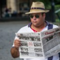 getty cuba man reading granma newspaper