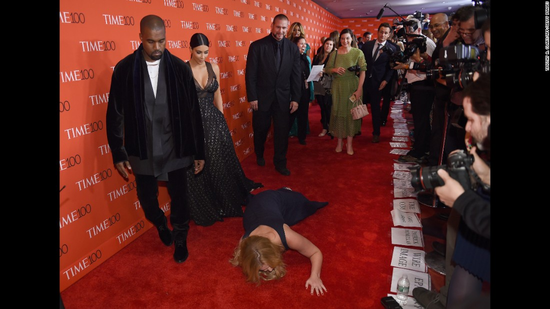 Honoree and comedian Amy Schumer pretends to trip and fall on the red carpet in front of fellow honorees Kim Kardashian and Kanye West at the TIME 100 Gala Tuesday night in New York.