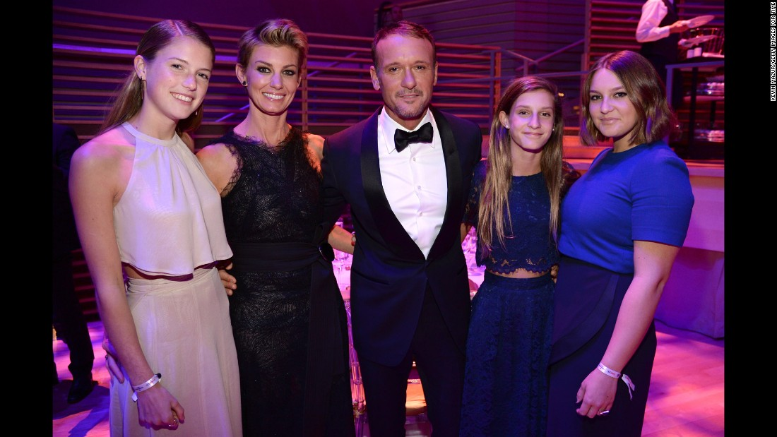 Country-music duo Faith Hill and Tim McGraw attend with their daughters, from left: Gracie McGraw, Audrey McGraw and Maggie McGraw.