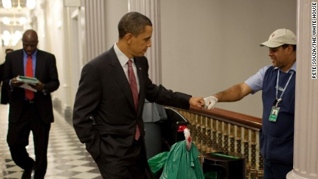 President Barack Obama fist-bumps custodian Lawrence Lipscomb in the Eisenhower Executive Office Building following the opening session of the White House Forum on Jobs and Economic Growth, December 3, 2009.