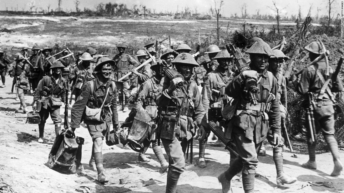 In a photo dated 1916,  Australian machine gunners march on a dirt road back from the front line trenches towards their billets, France, World War I.