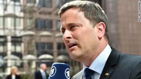 Luxembourg's Prime minister Xavier Bettel addresses reporters as he arrives at the European Council headquarters for an extraordinary summit of European leaders to deal with a worsening migration crisis, on April 23, 2015 in Brussels. European leaders gather on April 23 to consider military action, at an extraordinary summit to deal with a worsening migration crisis after a series of deadly shipwrecks in the Mediterranean. AFP PHOTO / PHILIPPE HUGUENPHILIPPE HUGUEN/AFP/Getty Images