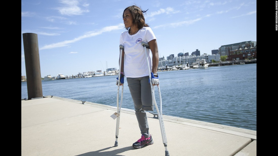 "<strong>Mery Daniel</strong>, a young mother from Haiti, was attending her second marathon when she was knocked to the pavement. She lost a leg, and the other leg was also damaged. She had pushed herself from ESL classes all the way to medical school, and instead found herself relearning how to walk with a prosthesis. She wears her ""Boston Strong"" T-shirt proudly."