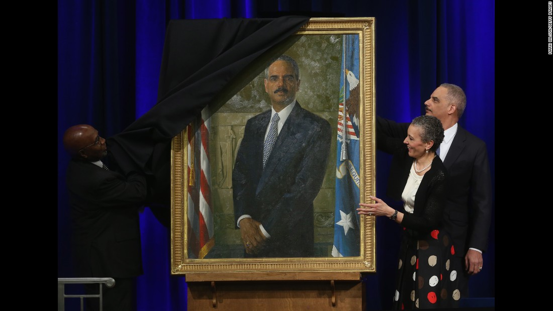 Holder and his wife, Sharon Malone, look on as artist Simmie Knox unveils Holder's official portrait during a ceremony at the Justice Department in Washington on Friday, February 27.