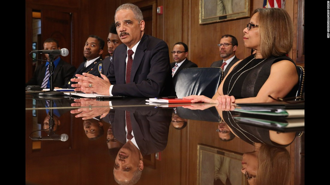 Holder delivers remarks about the shooting of two police officers in Ferguson, Missouri, at the Department of Justice in Washington on Thursday, March 12.