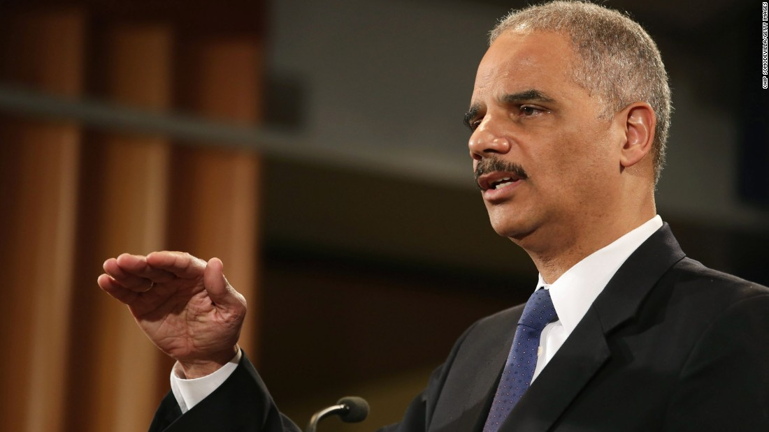 Holder takes questions at a news conference in May 2013. He said he recused himself from a national security leak investigation in which prosecutors obtained the phone records of Associated Press journalists.