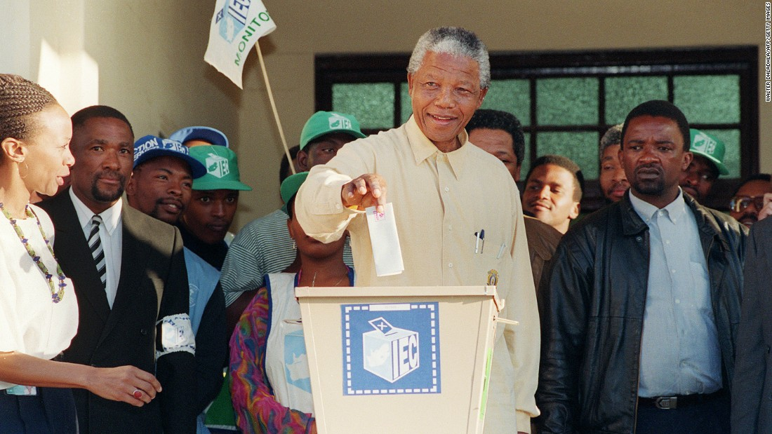 Nelson Mandela casts his historic vote during South Africa's first democratic general elections. The freedom fighter and president of the African National Congress, who had previously spent 27 years locked up in prison, reconciled South Africa after the fall of apartheid.