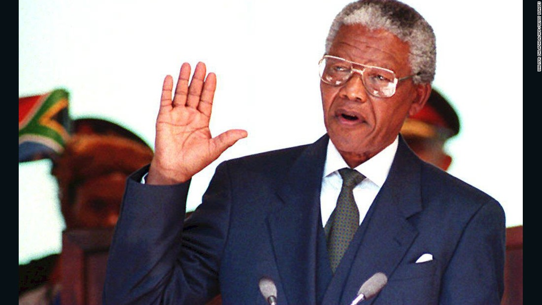 Mandela is sworn in on May 10, becoming South Africa's first black president.