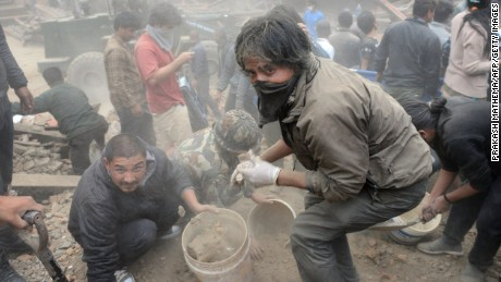 People clear rubble in Kathmandu's Durbar Square on April 25.