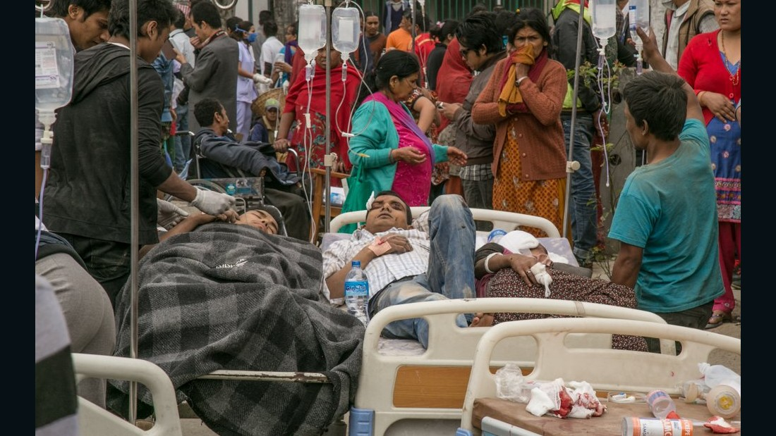 Anderson photographed people being treated in makeshift hospitals.