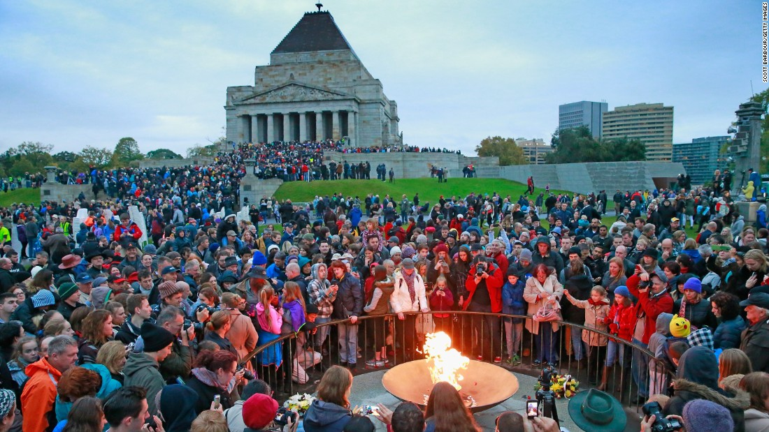 A large crowd gathers around the eternal flame for the 2015 dawn service on Anzac Day at the Shrine of Remembrance in Melbourne, Australia.