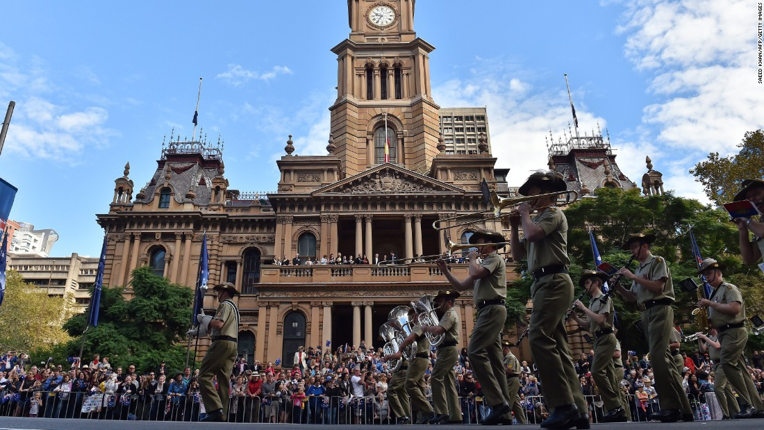 A marching band takes part in the Anzac Day parade along George Street in Sydney, Australia.