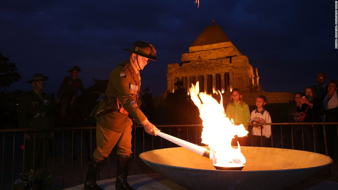 The Anzac  torch is lit at the Shrine Of Remembrance at Melbourne Cricket Ground on April 24, in Melbourne, Australia.