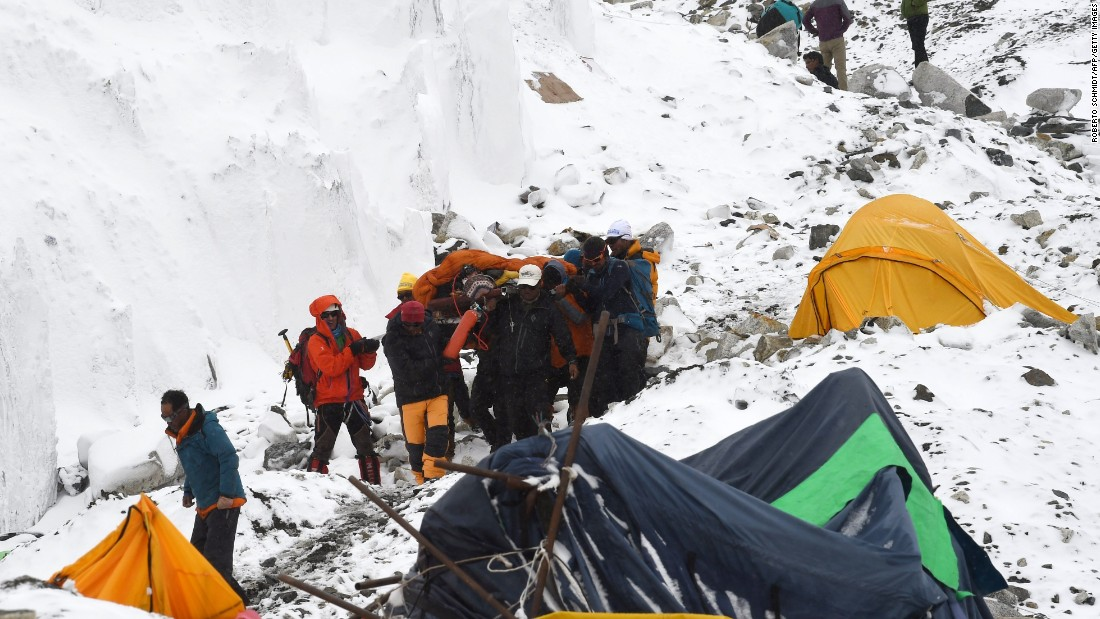 Rescuers carry a Sherpa injured by the avalanche on April 25.
