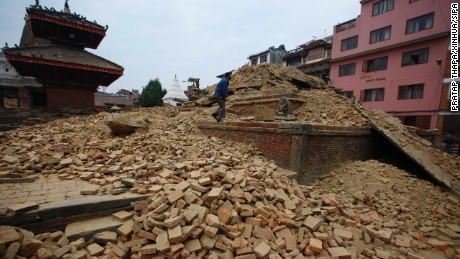 A  fallen temple is seen in Durbar Square in Patan, Nepal. While many structures in the square were heavily damaged, three major structures -- Krishna Mandir,  Bishwa Nath Mandir,  and the  Bimsen Mandi (not pictured) are believed to have survived largely intact.