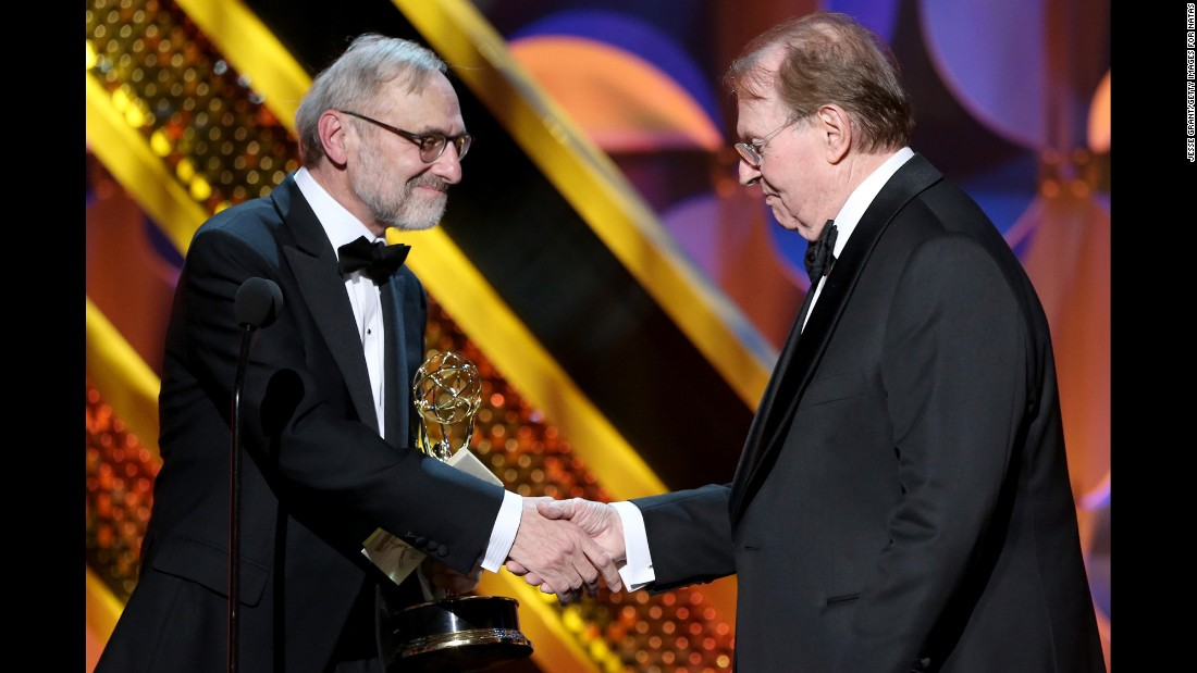 "Rand Morrison, left, and Charles Osgood accept the outstanding morning program award for ""CBS Sunday Morning."""