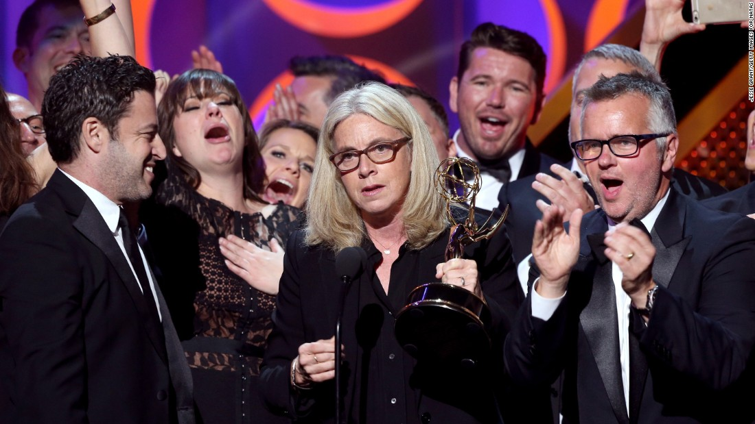 "From left, executive producers Andy Lassner, Mary Connelly and Ed Glavin accept the outstanding entertainment talk show award with the crew of ""The Ellen DeGeneres Show."""