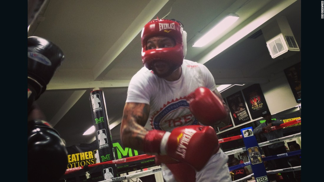 Theophane lands a right hook as part of his training session. The 34-year-old spars six consecutive lung-busting six-minute rounds. His opponent is replaced with a fresh fighter around three rounds, so his workout stays at a high level of intensity.