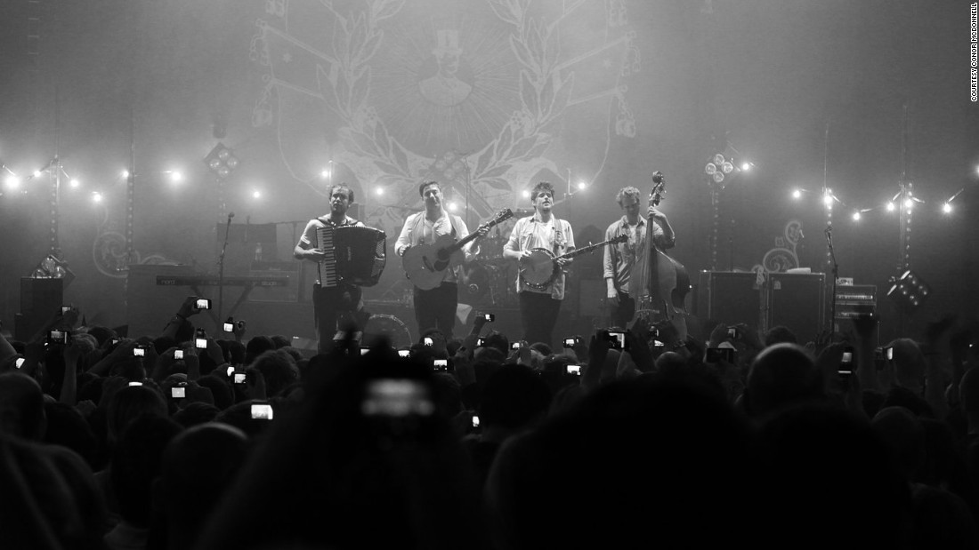 A shot from the crowd shows retro-styled folk rockers Mumford & Sons in an intimate setting.