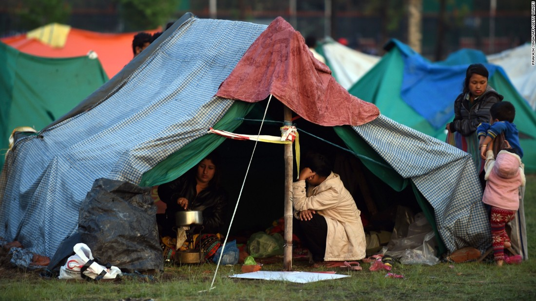 People rest April 28 in a temporary housing camp in Kathmandu. Large encampments of tents have sprung up in open areas, including a wide space belonging to the military in the center of the capital.